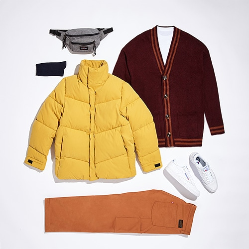 Your autumn outfit featuring a white T-shirt, burgundy cardigan, rust-coloured Levi