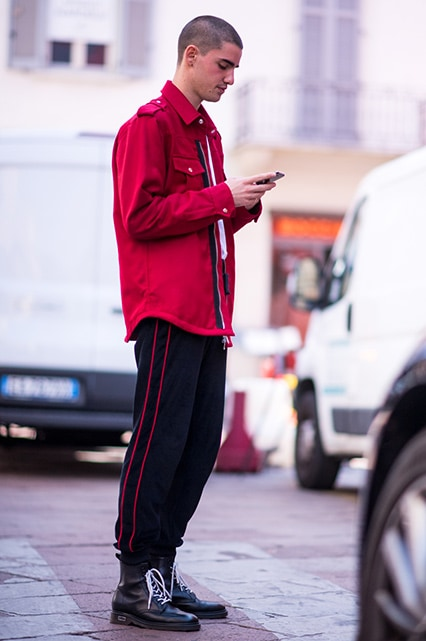 MFW SS18 Street Style featuring a street styler in a red shacket, side-stripe trousers and black lace-up boots | ASOS Style Feed