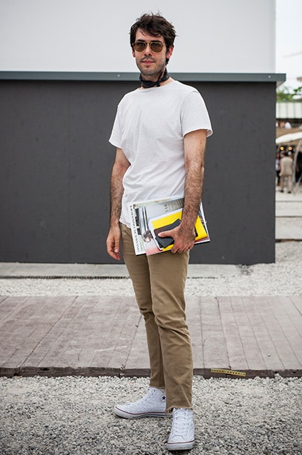 A street-styler wearing a white T-shirt, beige jeans, Converse trainers, retro sunglasses and a scarf | ASOS Style Feed