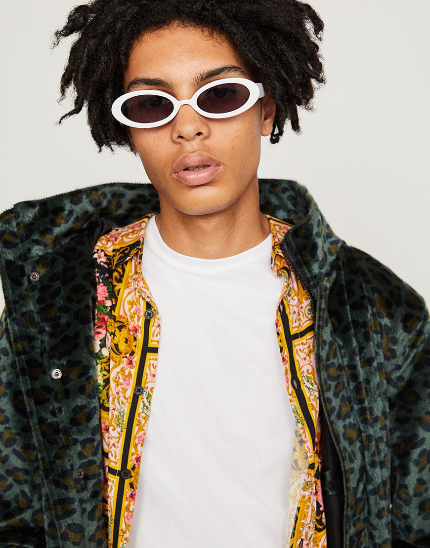 A model wearing sunglasses, a white T-shirt, a floral shirt and a leopard-print jacket available at ASOS | ASOS Style Feed