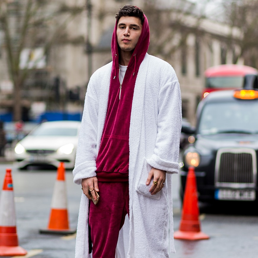 A street-styler wearing a velour tracksuit and white robe | ASOS Style Feed
