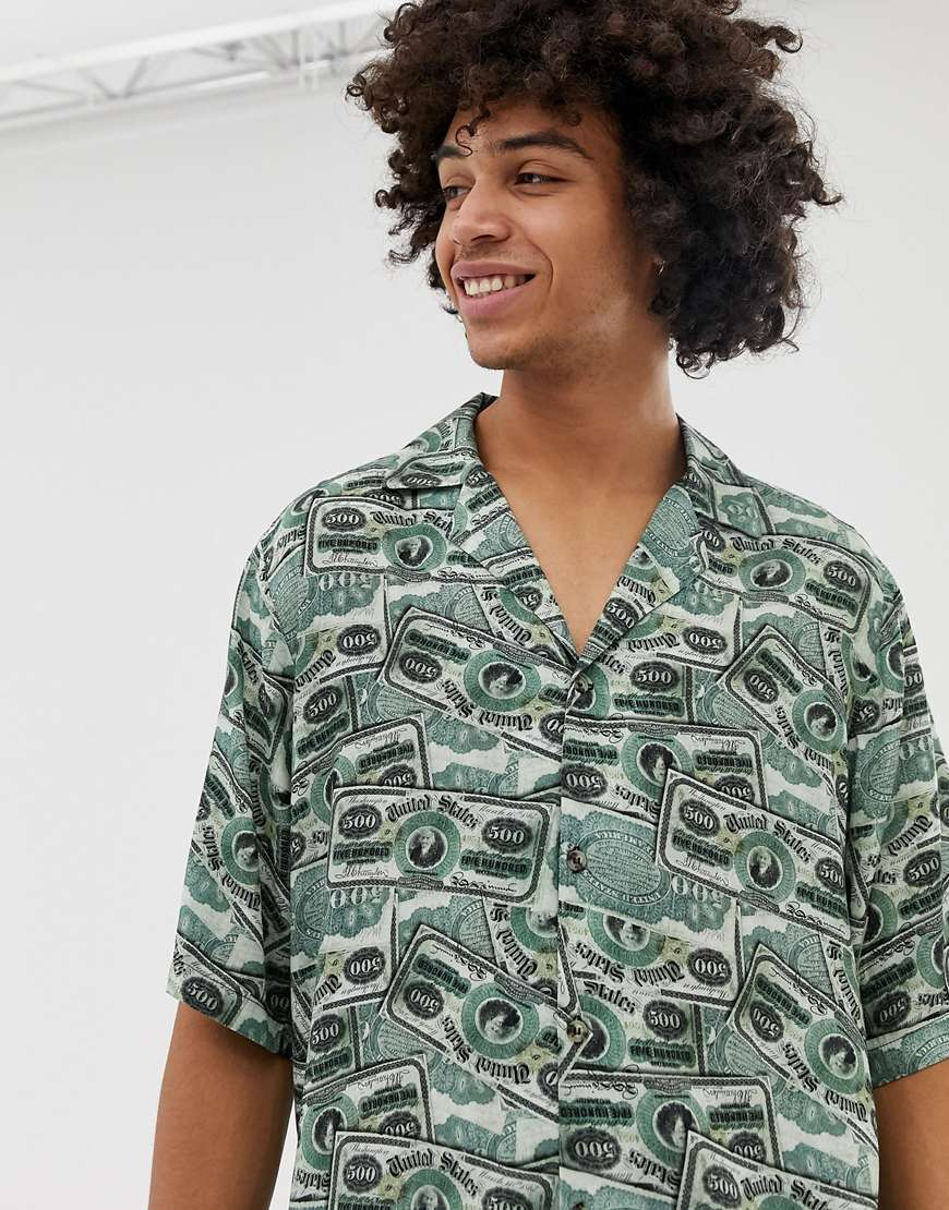 A picture of a man wearing a shirt featuring an all-over money print. Available at ASOS.