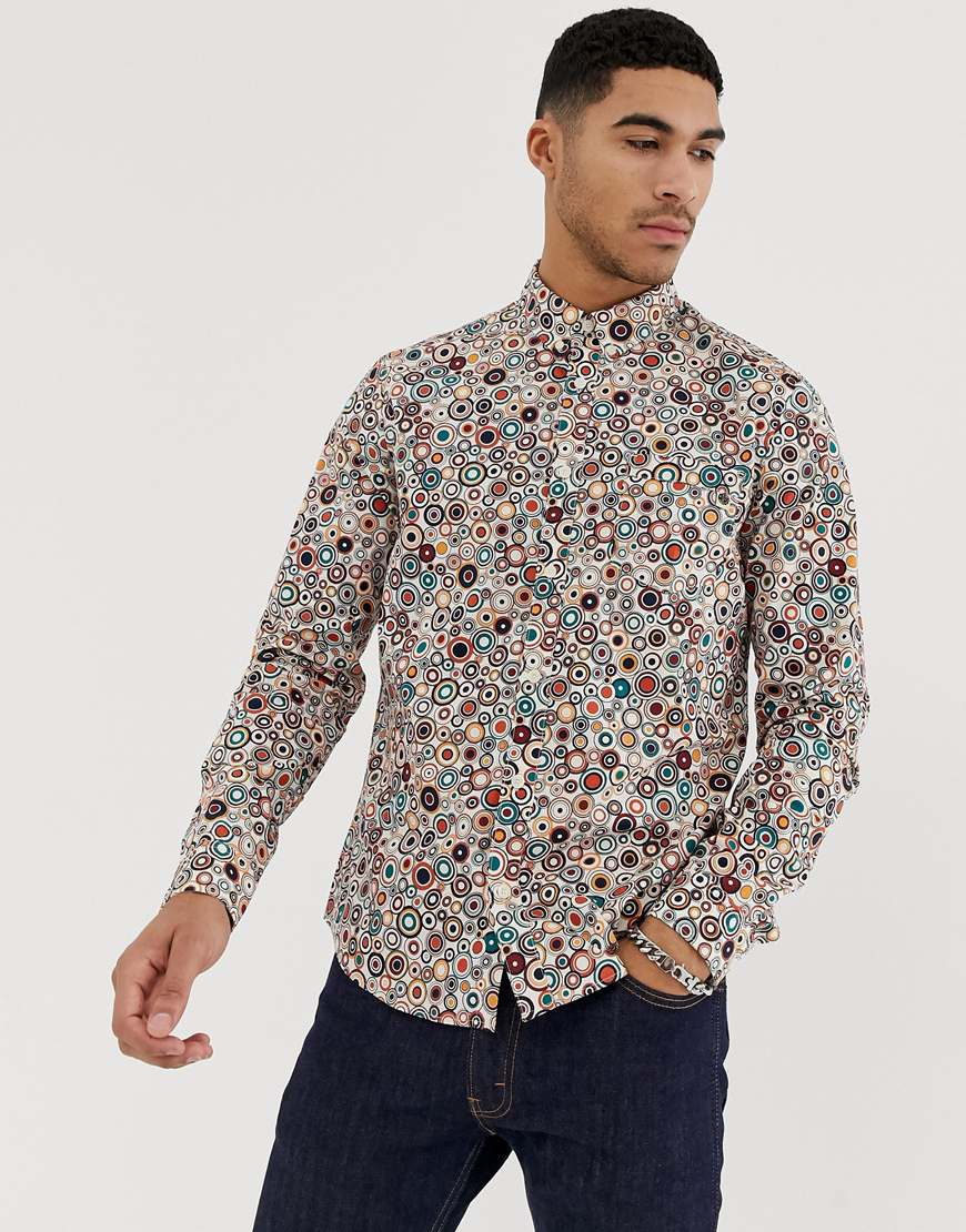A picture of a man wearing an all-over print shirt by Pretty Green, available at ASOS.