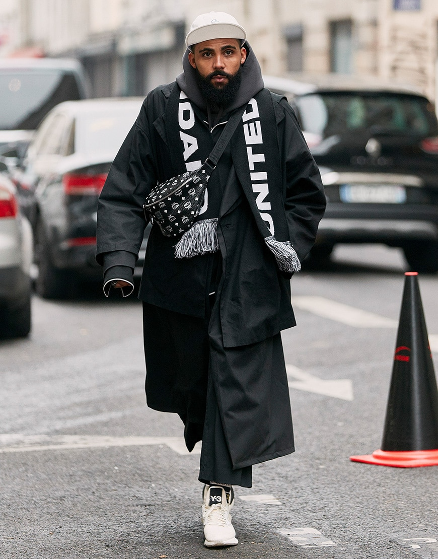 A picture of a street styler wearing a bum bag.