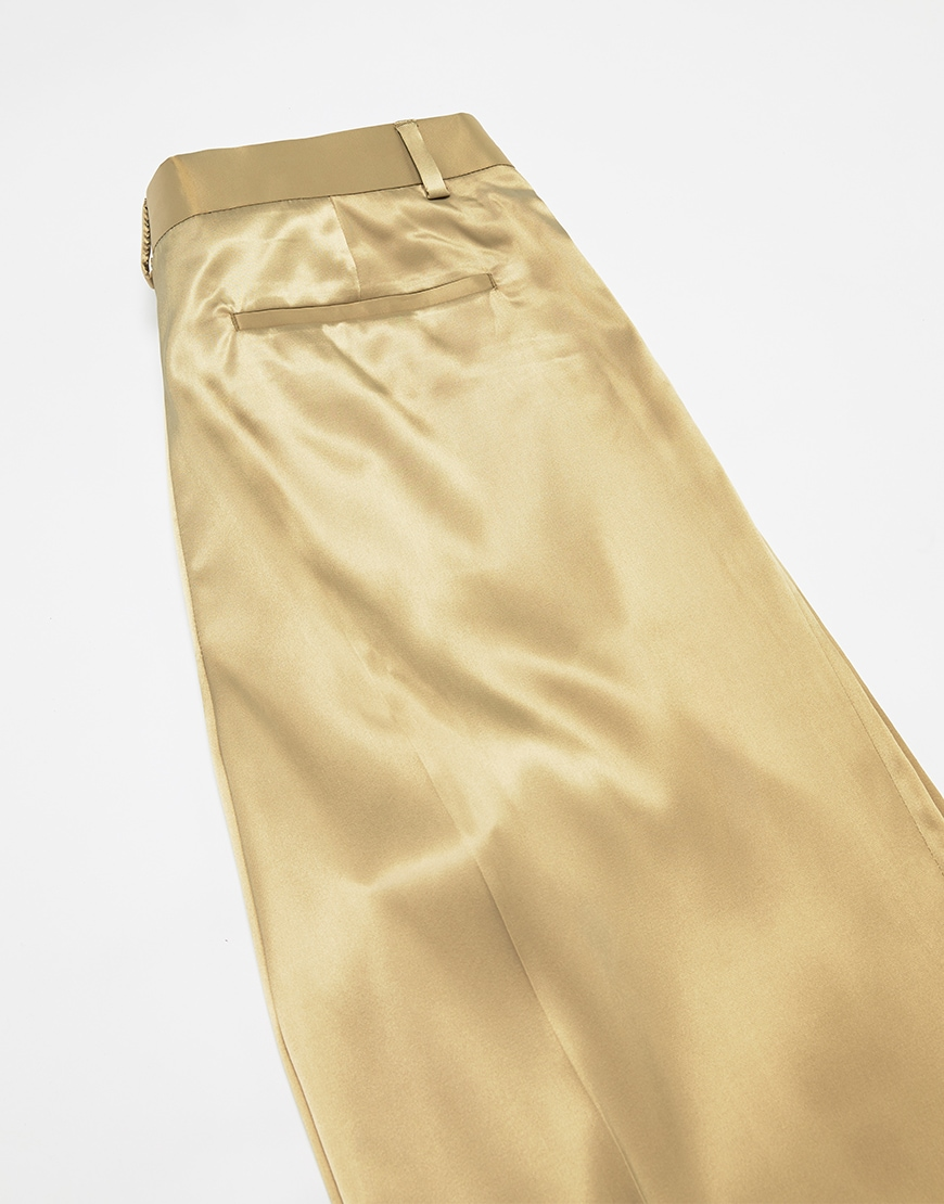 A picture of a pair of gold-tone, satin-style trousers. Available at ASOS.