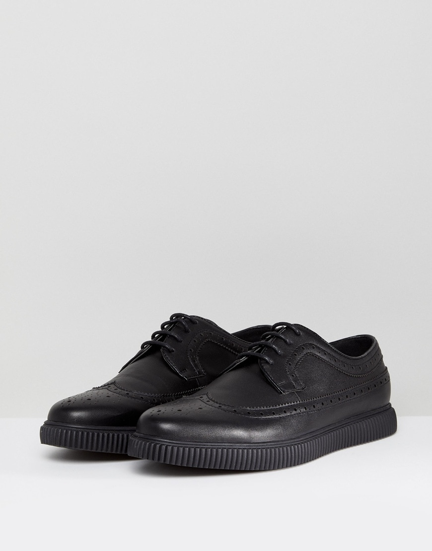 A picture of a pair of black shoes with a creeper sole. Available at ASOS.