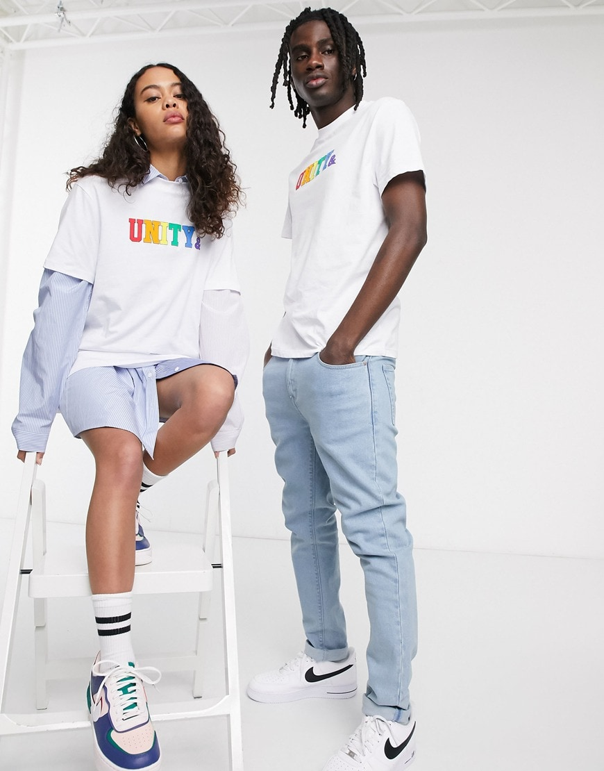A picture of a male and female model wearing white T-shirts  from the new ASOS X GLAAD collaboration featuring a rainbow-coloured 'Unity' logo. Available now.