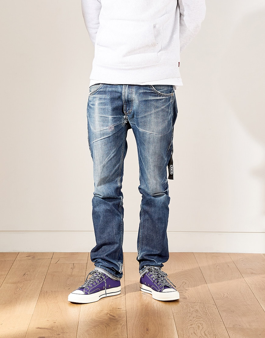 Nic wearing a hoodie, jeans and purple Converse available at ASOS | ASOS Style Feed