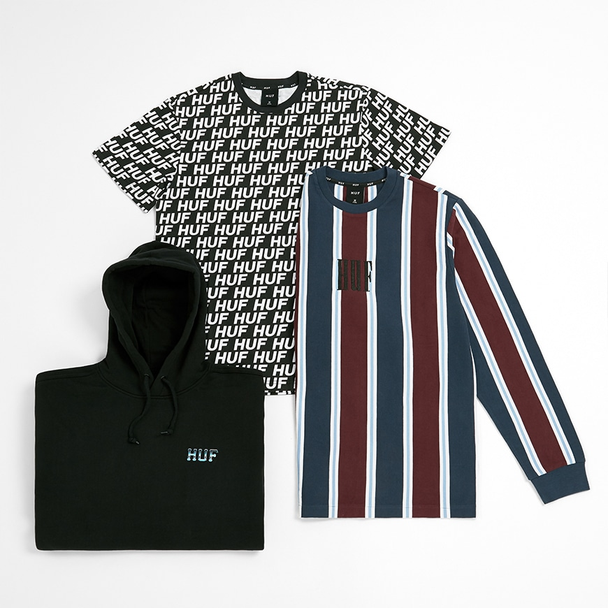 A black logo hoodie, all-over print T-shirt and striped, long sleeve T-shirt from skateboarding brand HUF