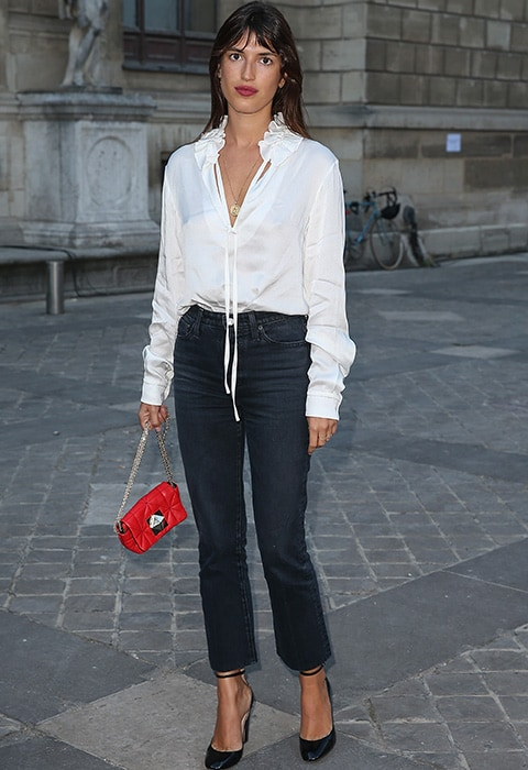 Jeanna Damas in a white shirt and black cropped flared jeans
