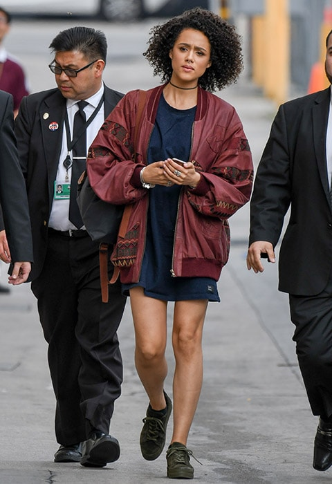 Nathalie Emmanuel wearing a t-shirt dress, khaki trainers and a burgundy jacket