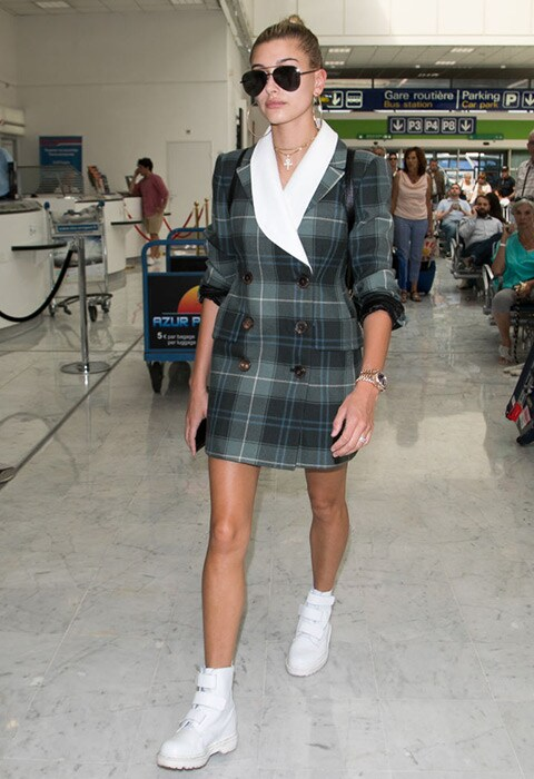 Hailey Baldwin wearing oversized check blazer and white hi-top trainers | ASOS Fashion & Beauty Feed