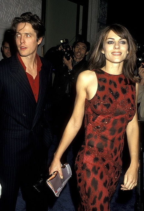 Elizabeth Hurley and Hugh Grant on the red carpet in 1996 | ASOS Fashion & Beauty Feed