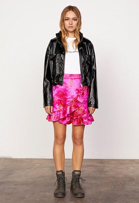 Model wearing a pink brocade skirt and vinyl jacket | ASOS Fashion & Beauty Feed