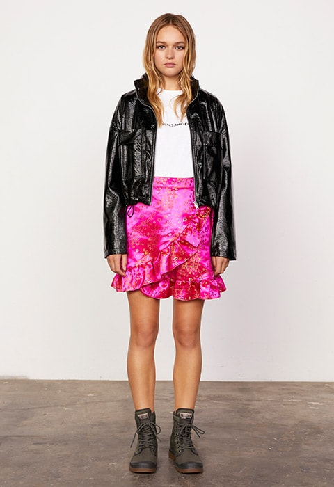 Model wearing a pink brocade skirt and vinyl jacket | ASOS Fashion & Beauty Feed