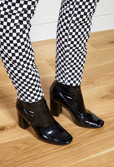 Nicole Privett wearing checkerboard trousers | ASOS Fashion & Beauty Feed