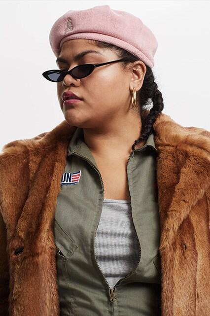 Artist Al Ly wearing a brown faux fur coat   ASOS Fashion & Beauty Feed