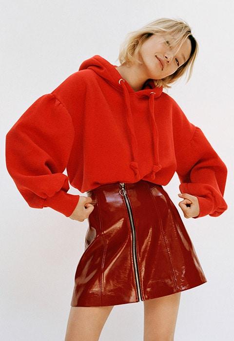 Model wearing a Bershka hoodie and vinyl skirt | ASOS Style Feed