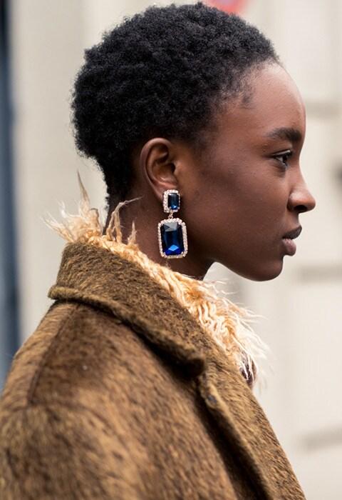 Model wearing diamante drop earrings at Milan Fashion Week AW18