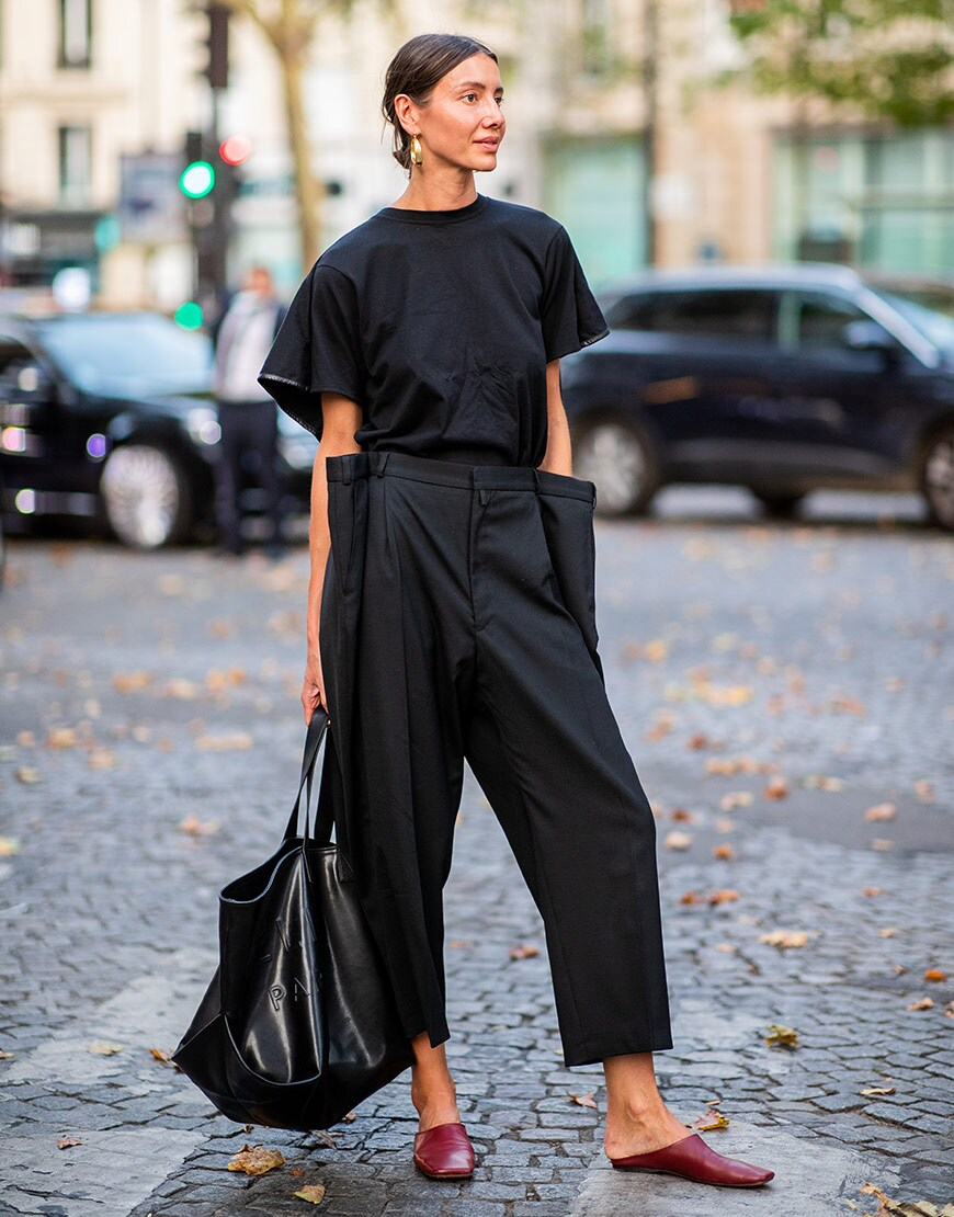 A street styler wears black trousers and mules at Paris couture  | ASOS Fashion & Beauty Feed