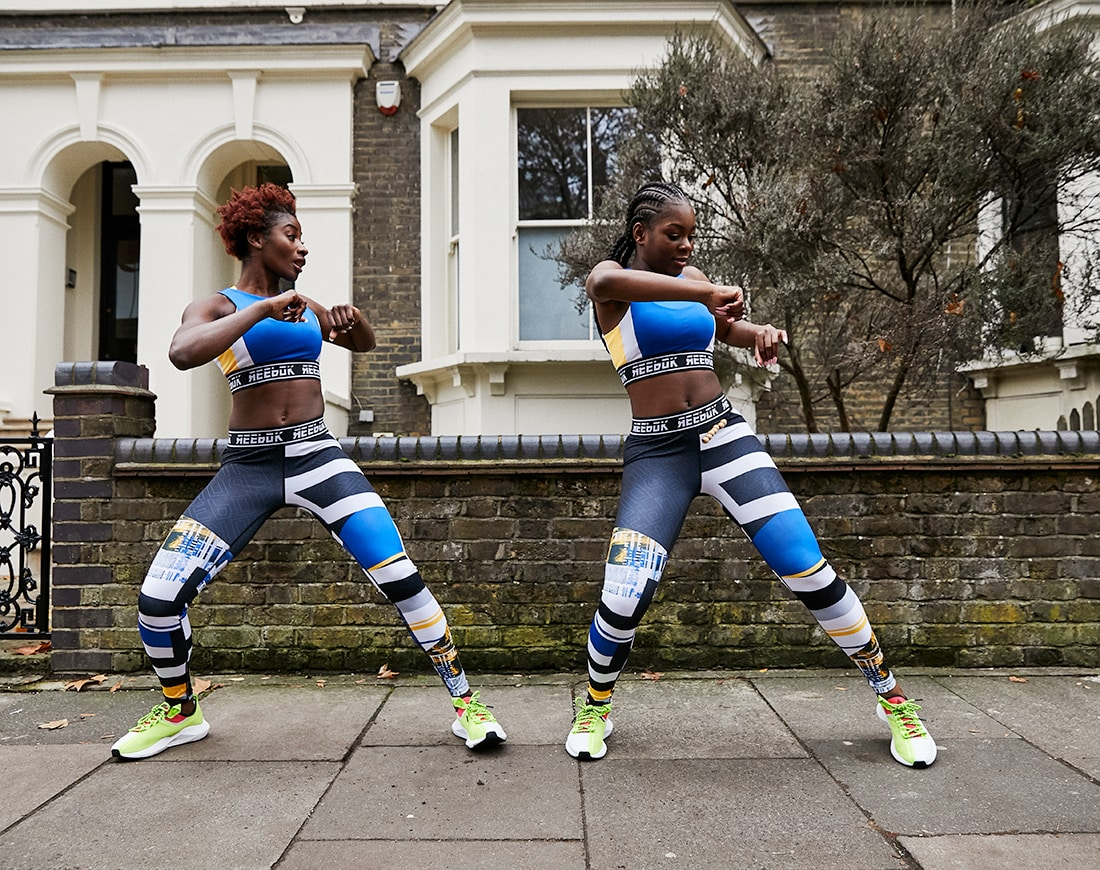 A picture of two women dancing in Reebok sportswear. Available on ASOS.